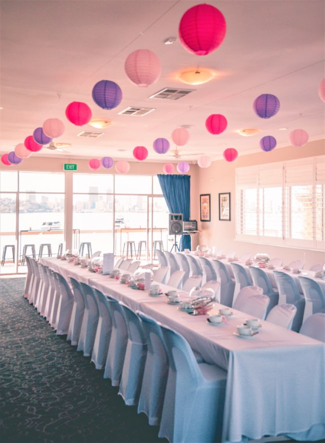 White table setup for a party hosted in Mounts Bay's Col Taylor Lounge