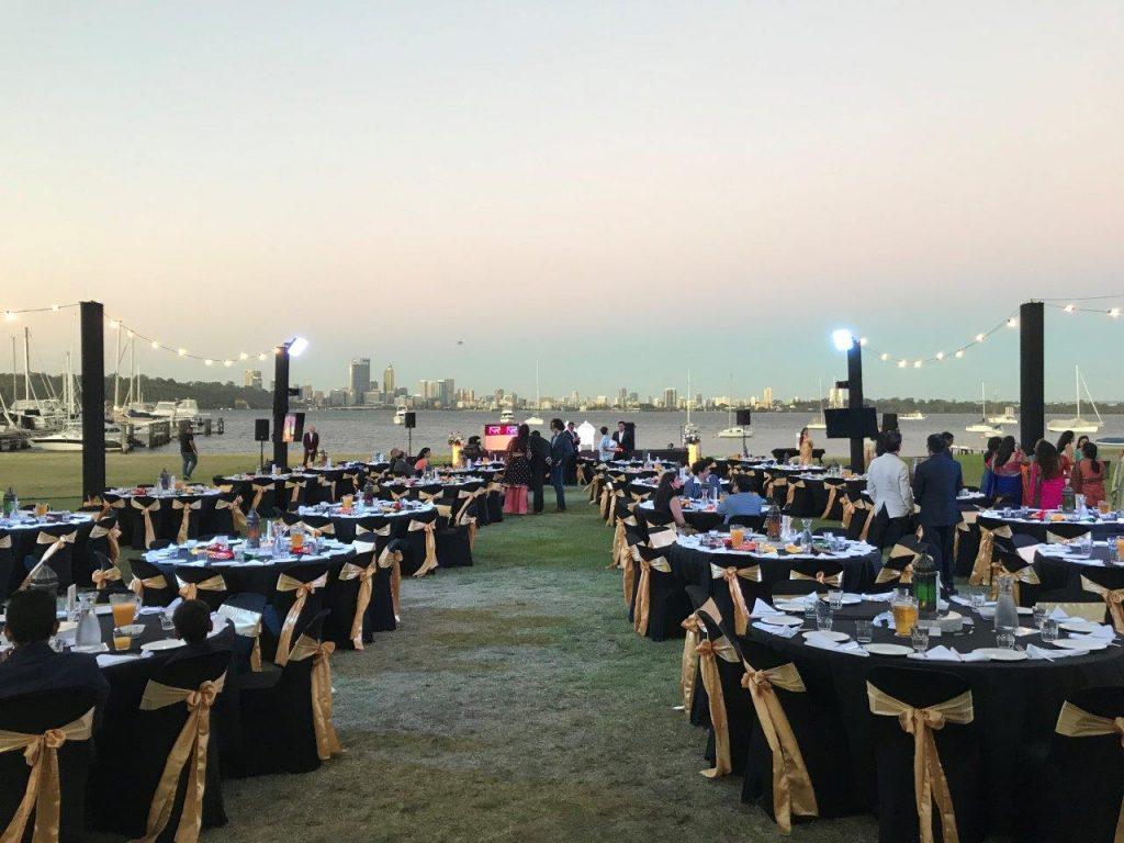 Black and gold themed dinner party beside the Swan River