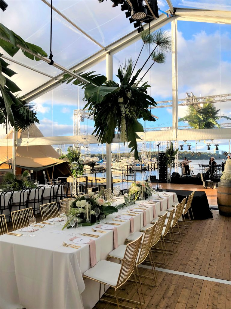 White and old rose themed wedding dinner held inside Mounts Bay's light and airy Col Taylor Lounge along with a live band