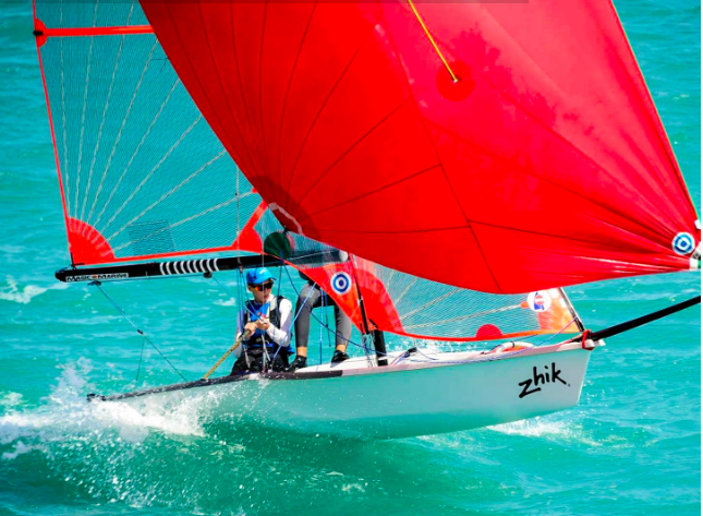 Two people sailing on a 29er boat