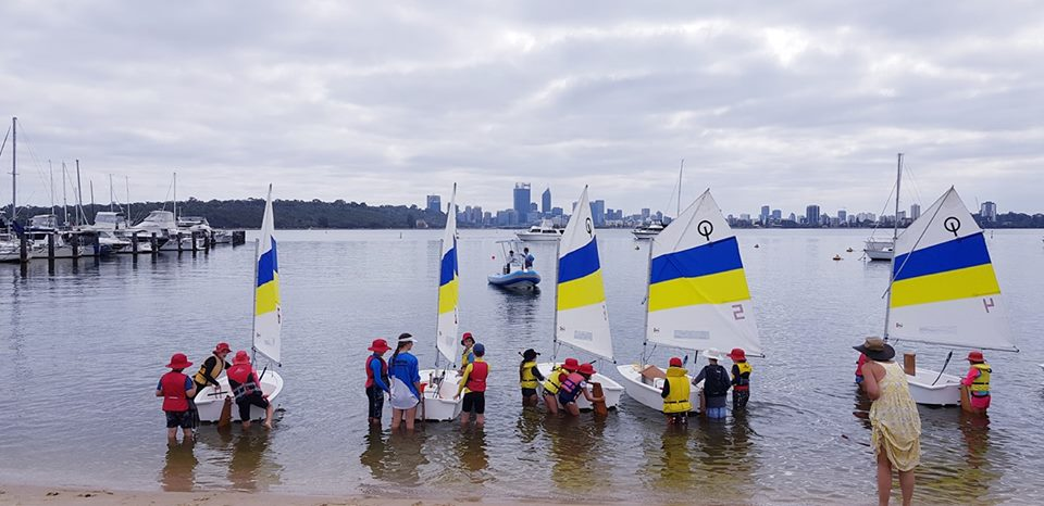 Kids getting ready to sail