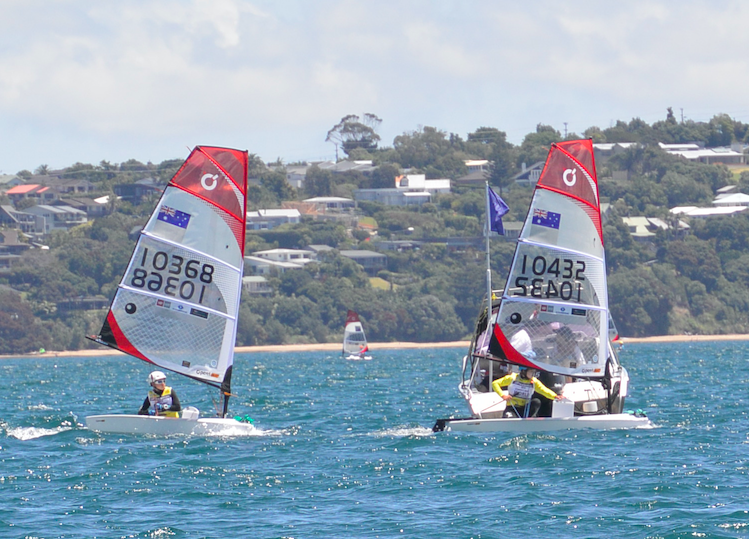 Two O'PEN Bic sailors competing against each other