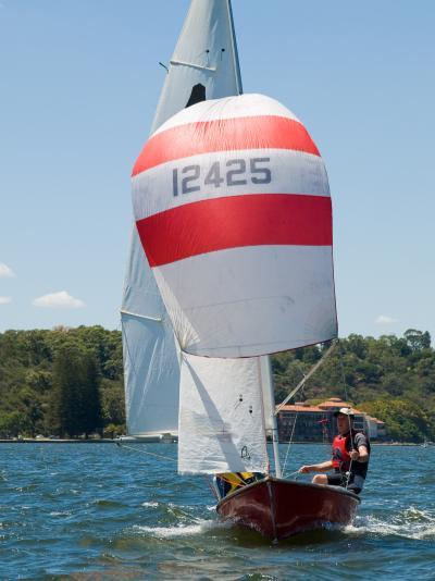 A man sailing on a GP14