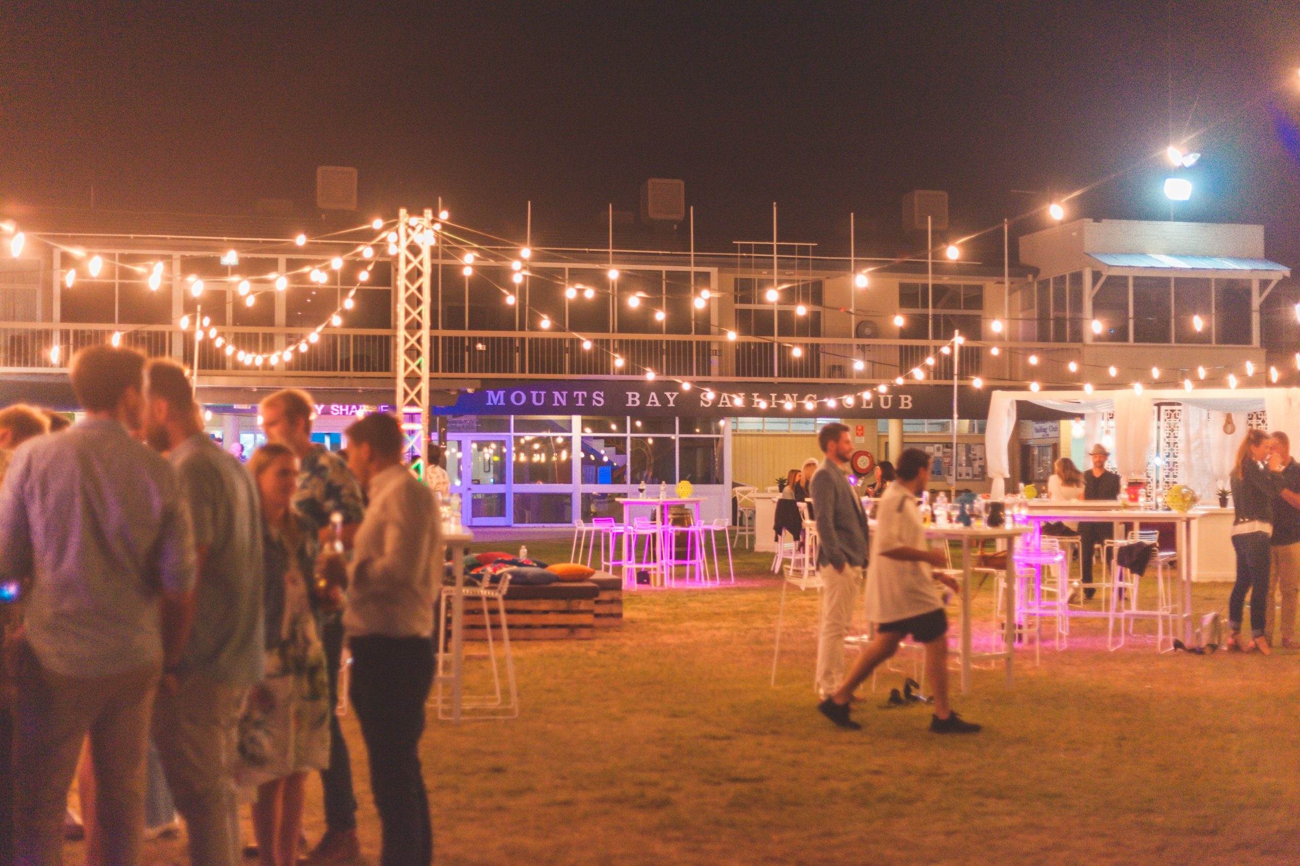 A business event happening in Mounts Bay at night